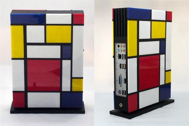 :: Mondrian, The Fanless Mini PC From Jeffrey Stephenson ::  Jeffrey Stephenson is well known for creating custom PCs using wood, although this time Jeffrey's latest creations is a little different, as well as using a range of wood he has also used acrylic to create the Mondrian, a mini fanless PC inspired by the Dutch artists Piet Mondrian. The Mondrian was created using birch plywood basswood and colored hand cut acrylic tiles and uses a fanless mini-ITX design.  The Mondrian is powered by an Intel Core i3-2105 processor, and also features Intel HD graphics, a 256GB SSD, 8GB of RAM and a 120w picoPSU, for the OS Jeffrey has installed Windows 8 Consumer Preview