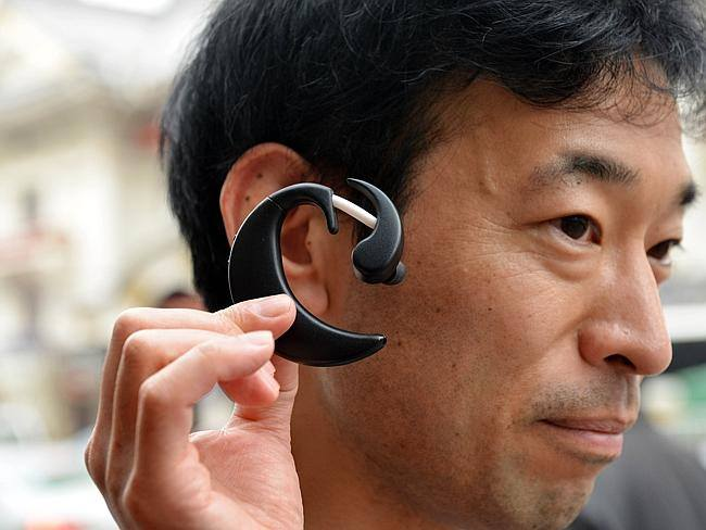... Japan researchers testing tiny ear computer ...  A TINY personal computer that is worn on the ear and can be controlled with the blink of an eye or the click of a tongue is being tested in Japan.