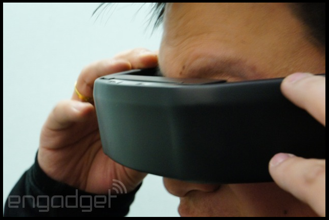 "... AVEGANT GLYPH HOME THEATER HEADSET ...  The home theater headset just got a name, and the first prototype looked an awful lot like what you'd see underneath a Terminator cyborg's smooth visage. As Oculus did before, the scrappy eight-person team at Avegant is taking its impressive proof-of-concept to Kickstarter in hopes of funding a beta unit: $500 is the base level for a Glyph, and the project is set to go live on January 22nd. And this sentence — right here! — is where we're gonna stop speaking about the Glyph as if it's competing with the Oculus Rift. As Avegant's CEO Ed Tang told us late last week: ""We're not trying to compete with Oculus."""